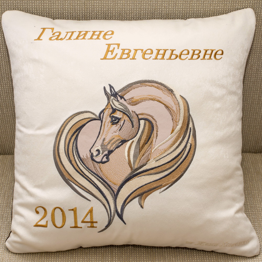 White pillowcase embroidered with horse design