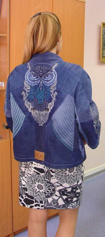 Embroidered denim jacket with tribal owl