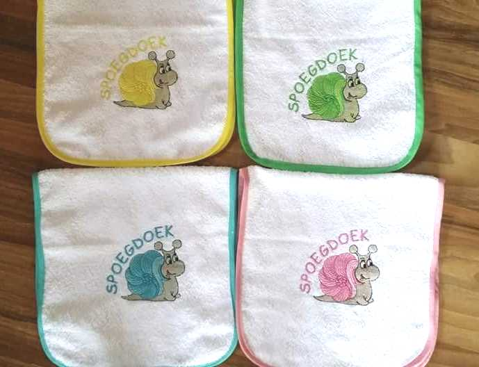 Embroidered baby bibs with snail free design