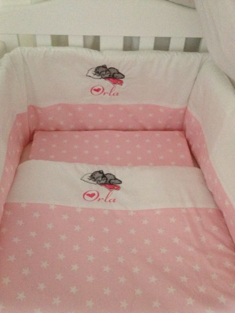 Teddy bear sleeping design embroidered on pink blanket