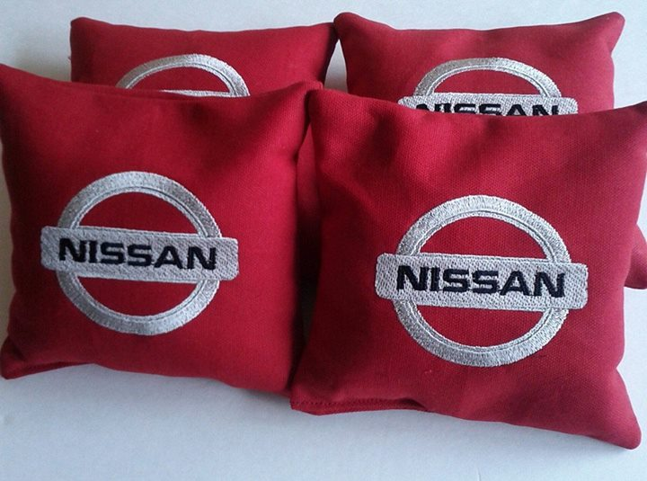 Nissan logo on pillowcase embroidered