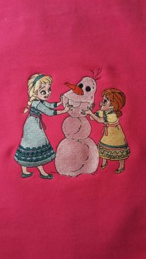 Making snowman Anna and Elsa on embroidered pink girlish hoodie