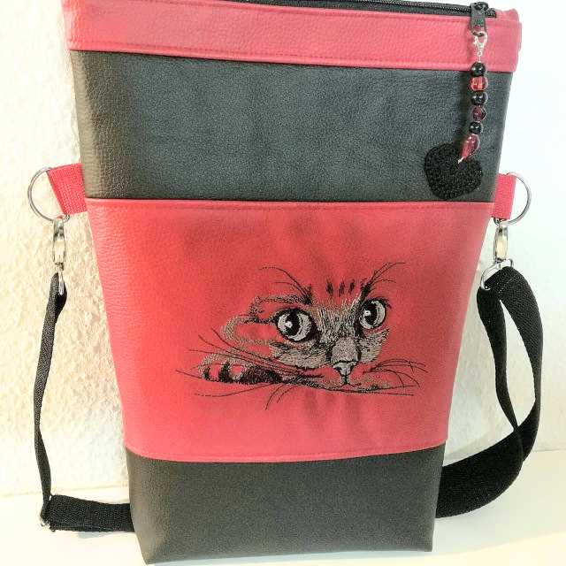 Embroidered bag with cat muzzle design