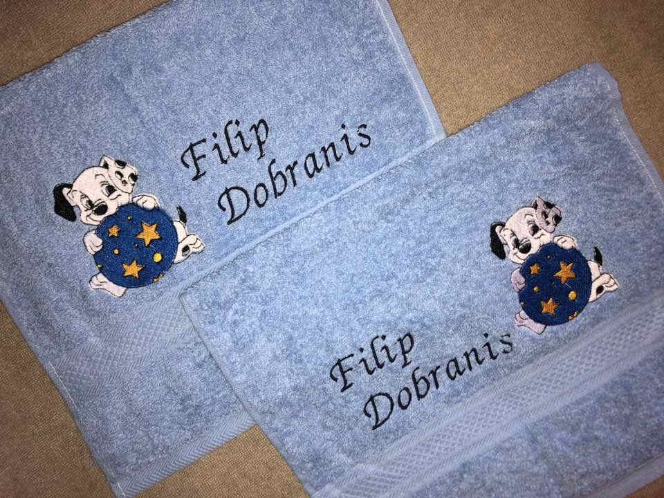 Two towels with puppy embroidery designs