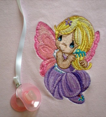 Embroidered fairy on babywear