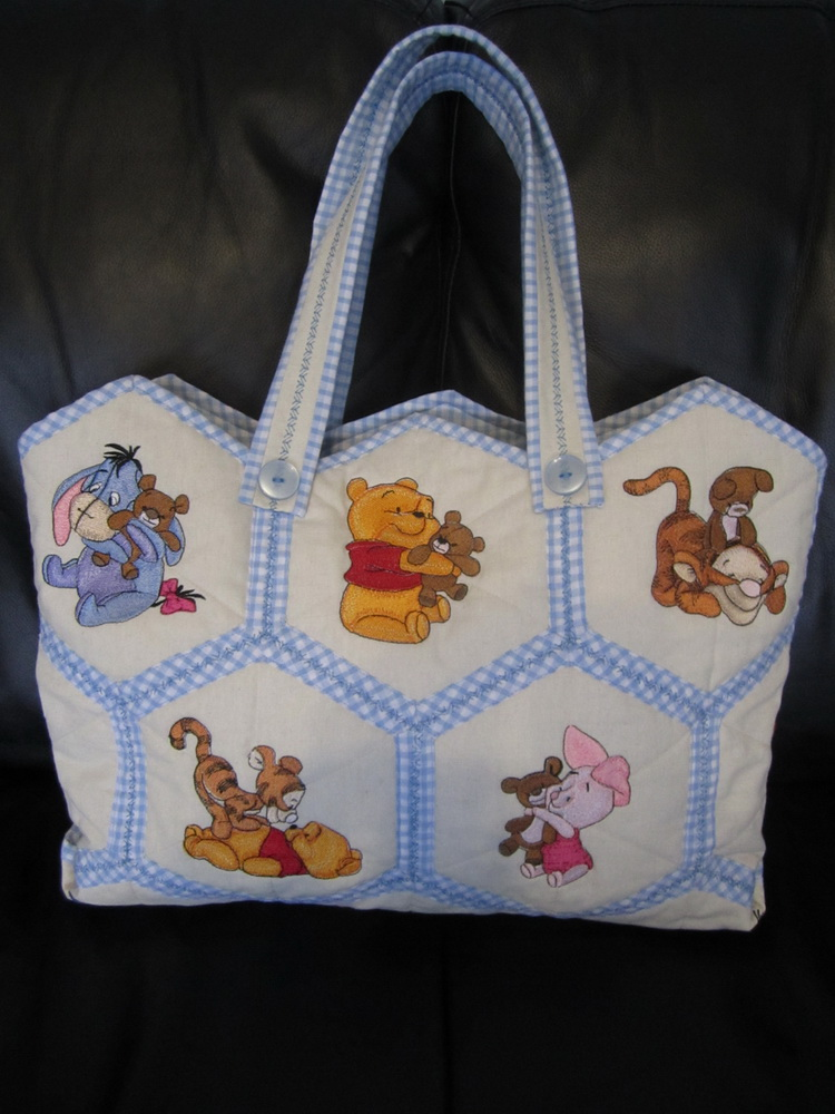 Baby pooh designs on embroidered nappy bag