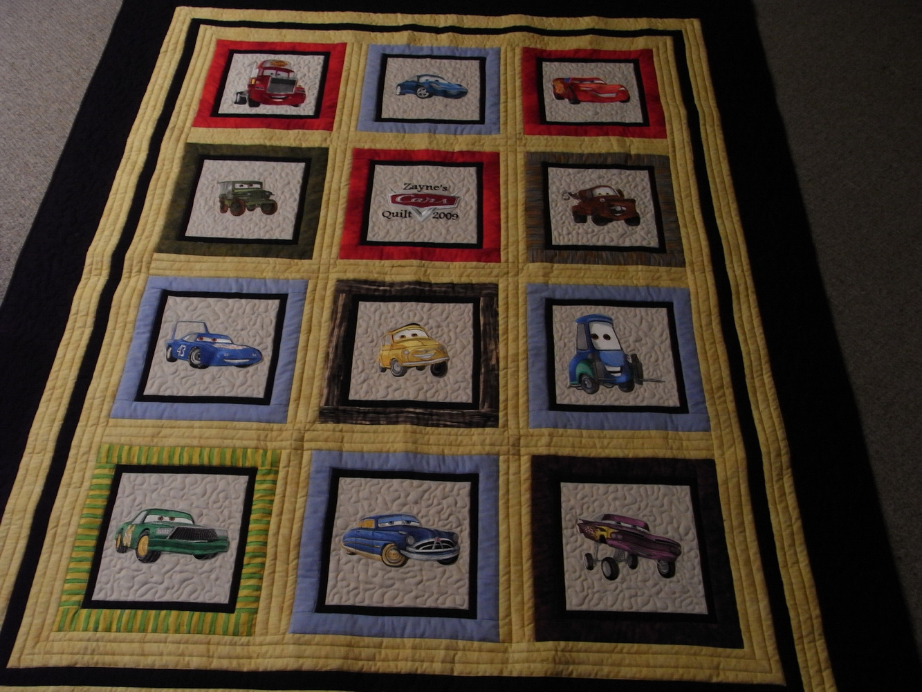 Cars designs on quilt embroidered