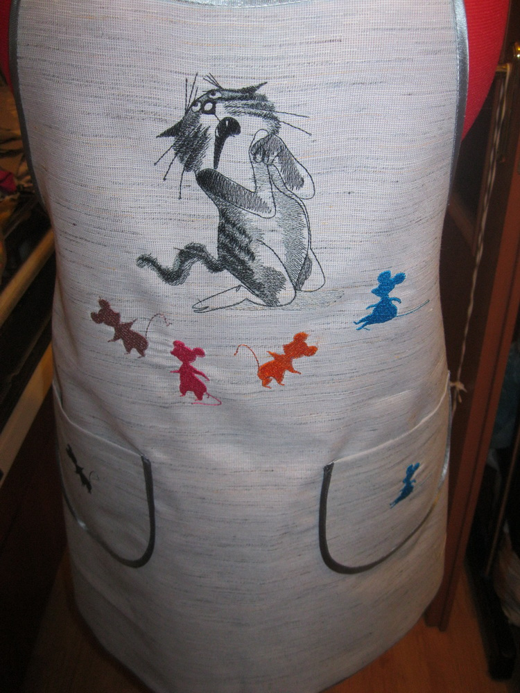 White apron with embroidered cat