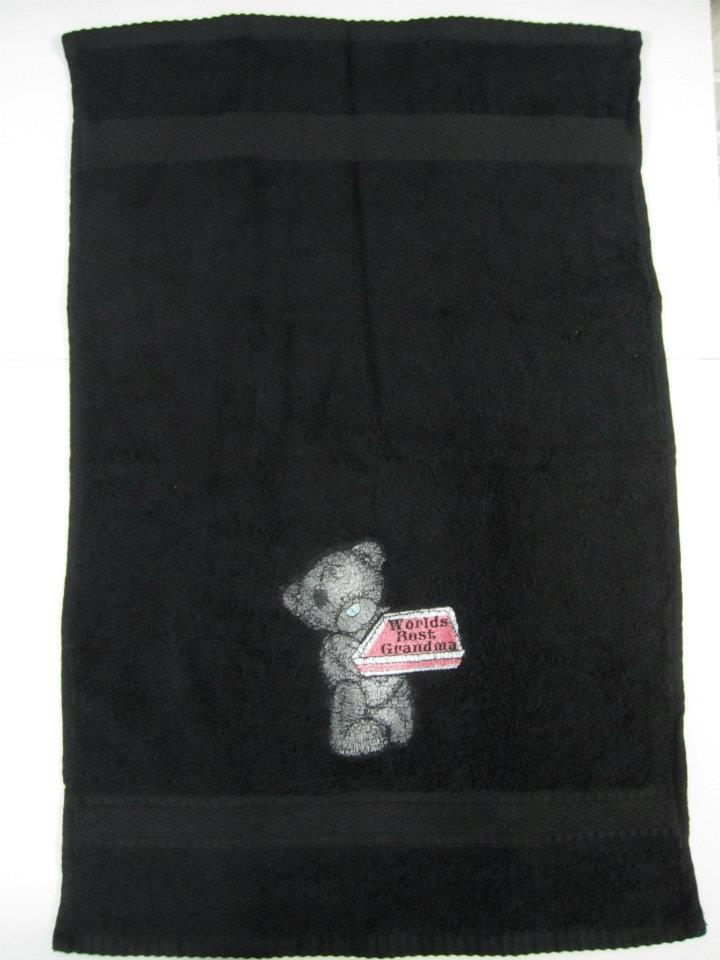 Black bath towel embroidered with tatty teddy