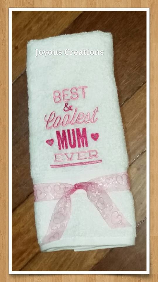 White bath towel embroidered with Best coolest mom ever design