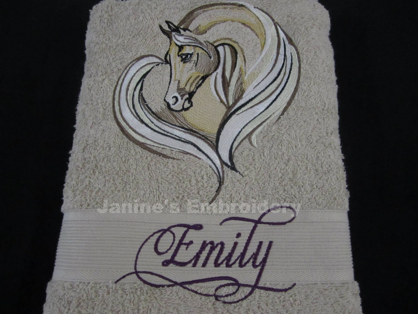 Bath towel with embroidered horse