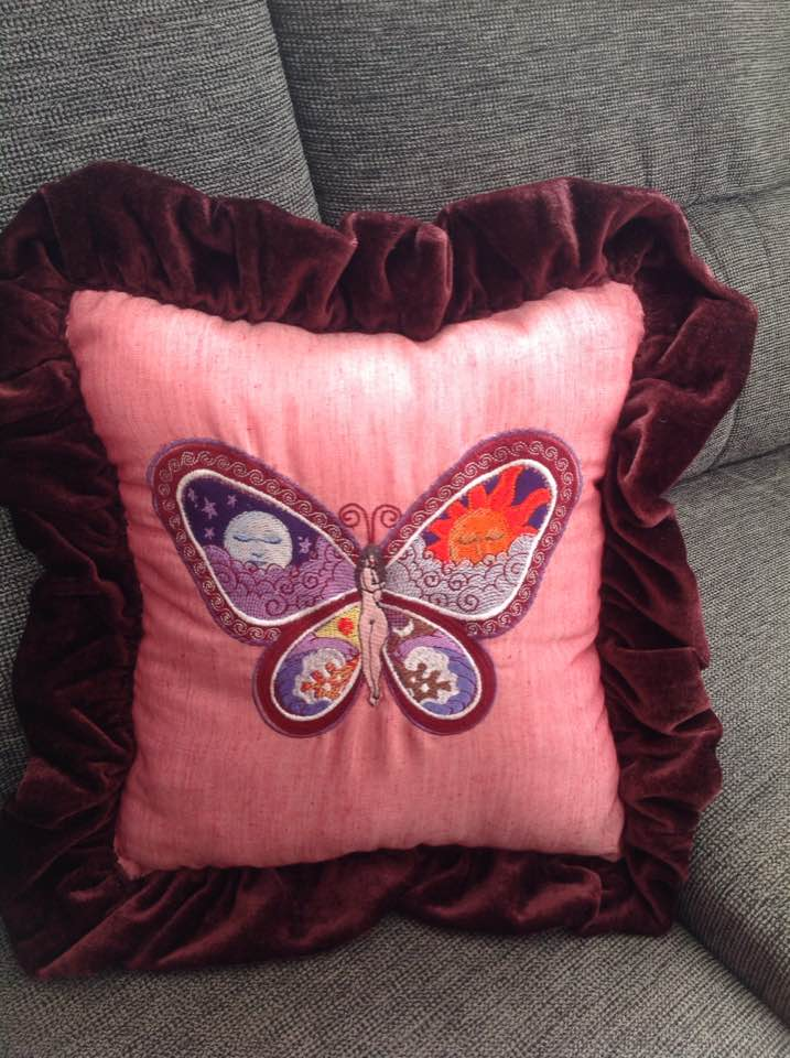 cushion with day and night butterfly embroidery design