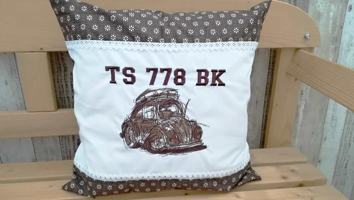 Embroidered cushion with vintage sketch car design