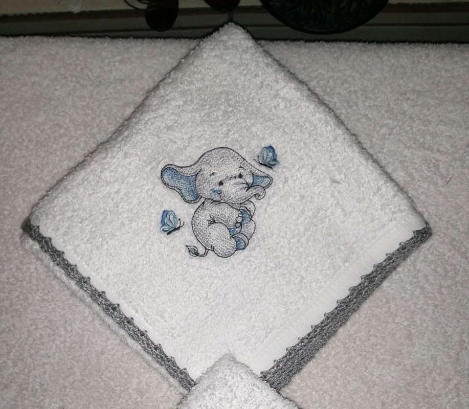 Adorable bath towel with cute dancing elephant design