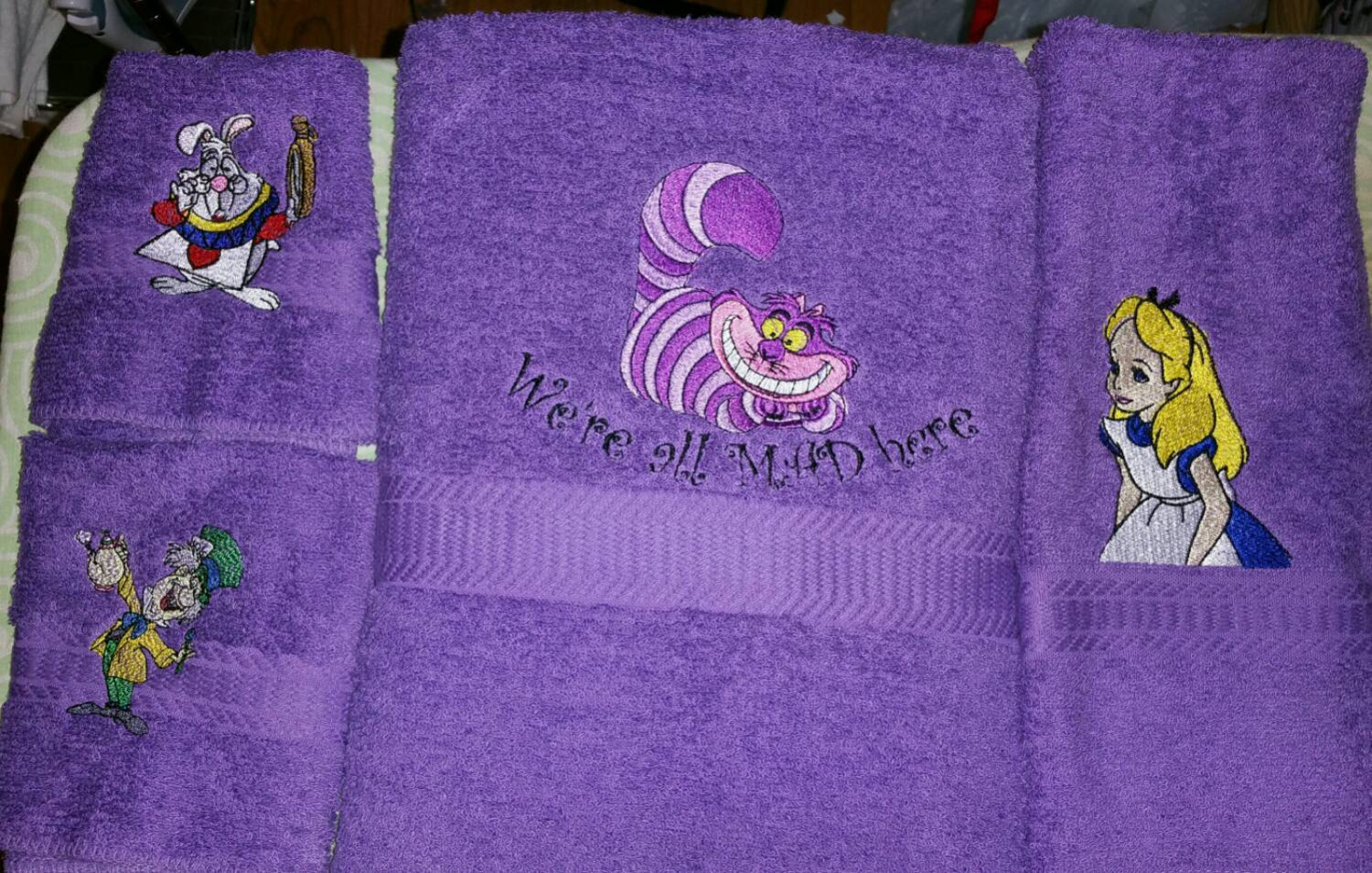 Alice in wonderland characters on embroidered purple bath towels