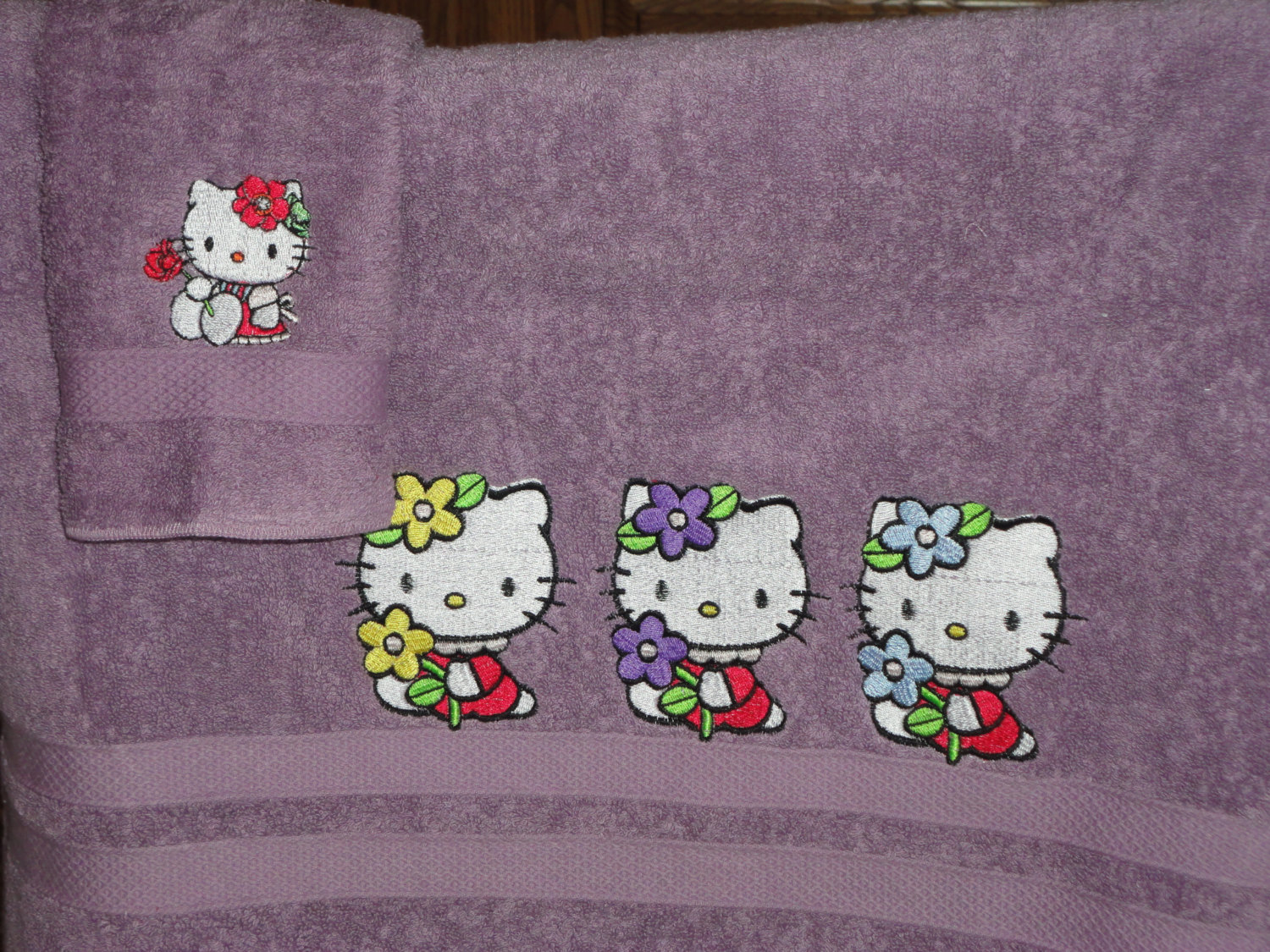 Embroidered Hello Kitty designs on towels