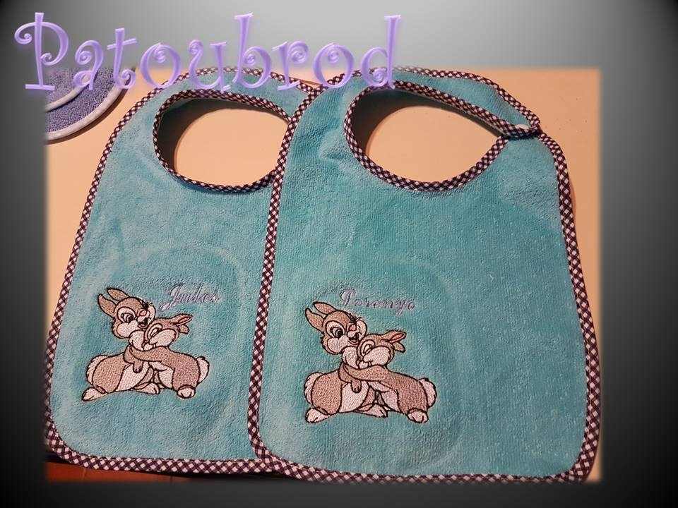 Blue embroidered baby bibs with Bambi's friends