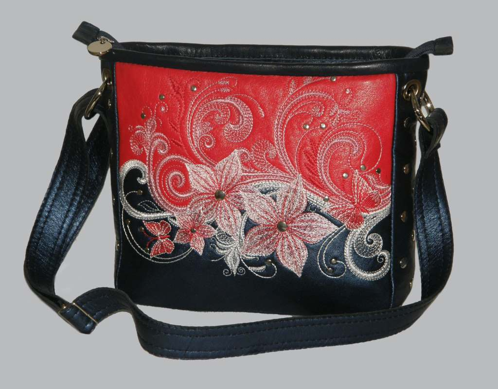 Woman handbag with flower pattern