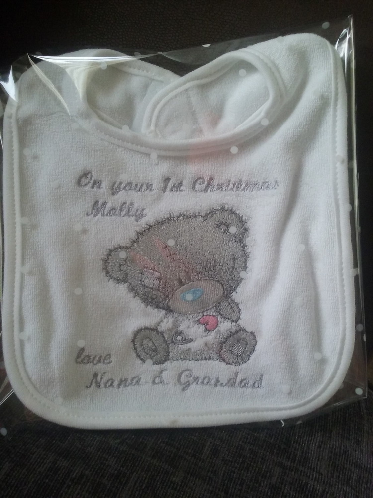 Blue nose teddy bear embroidered on baby bib