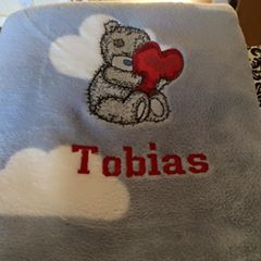 Teddy Bear with a pillow heart design on embroidered fleece blanket