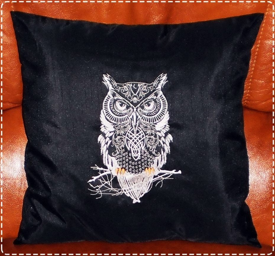 Tribal owl embroidered on black pillowcase