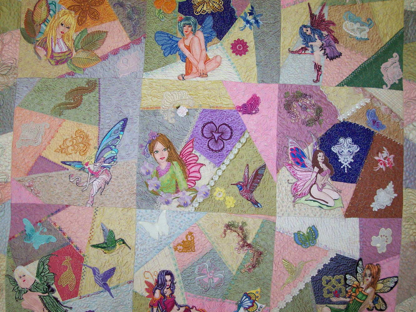 Fairies designs on quilt embroidered