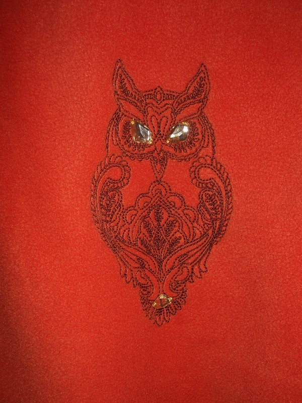 Embroidered owl on orange fleece hoodie