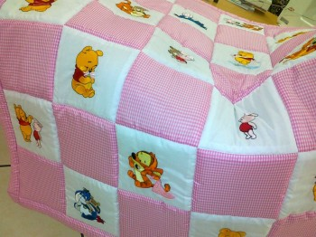 Girlish quilt with embroidered Pooh's friends