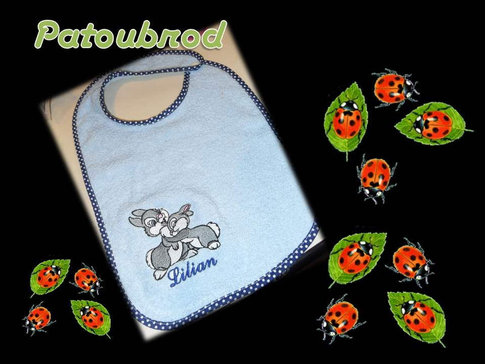 Embroidered blue bib with cute bunnies