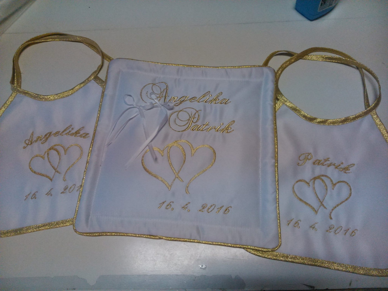 White embroidered bibs with two hearts design