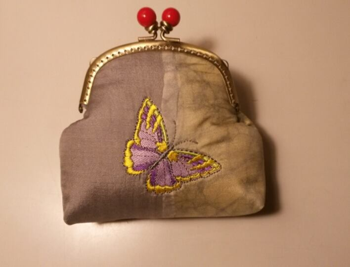 Butterfly design on bag embroidered