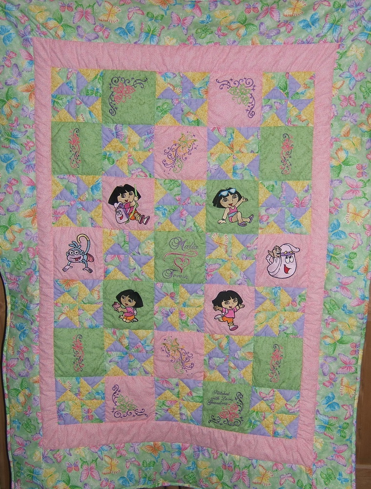 Dora explorer designs on embroidered blanket