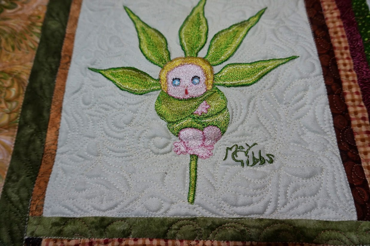 Snugglepot embroidery design on quilt