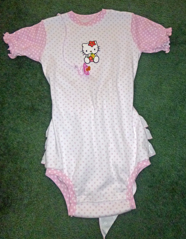 Hello Kitty with sea of flowers design on babywear embroidered