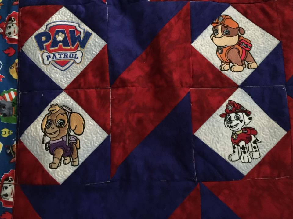 Paw Patrol designs on embroidered quilt