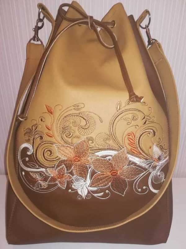 Embroidered fashion leather bag with flowers design