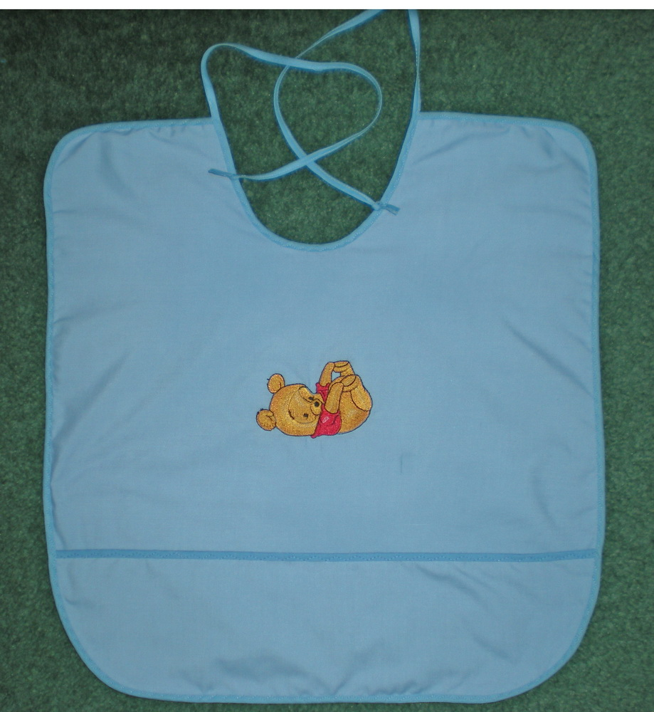 Cute baby bib with Pooh embroidered