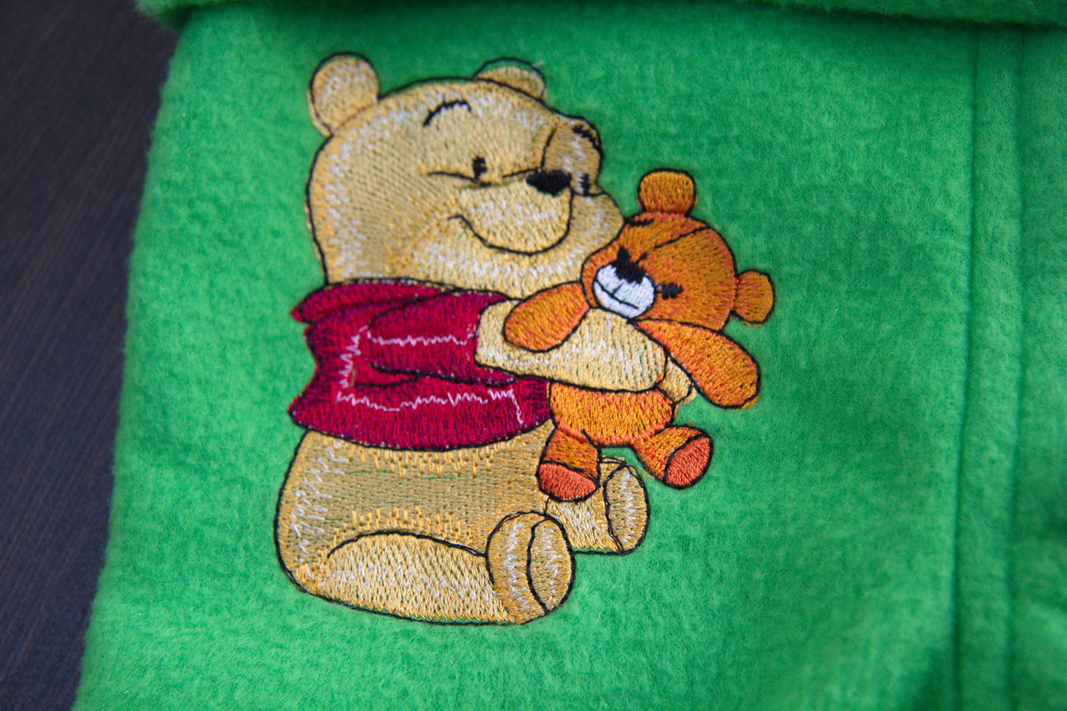 Baby Pooh with toy design on baby wear embroidered