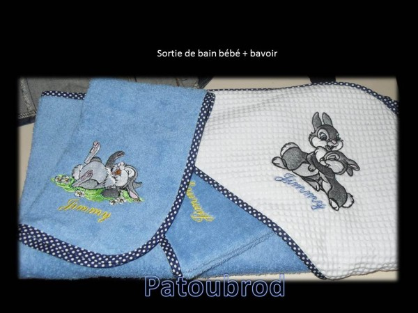 Cute bunnies on embroidered blue bath towels