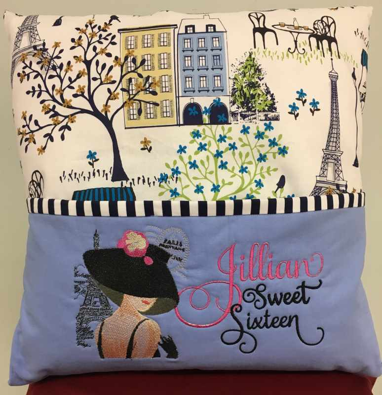 Sofa pillow with French woman free embroidery design