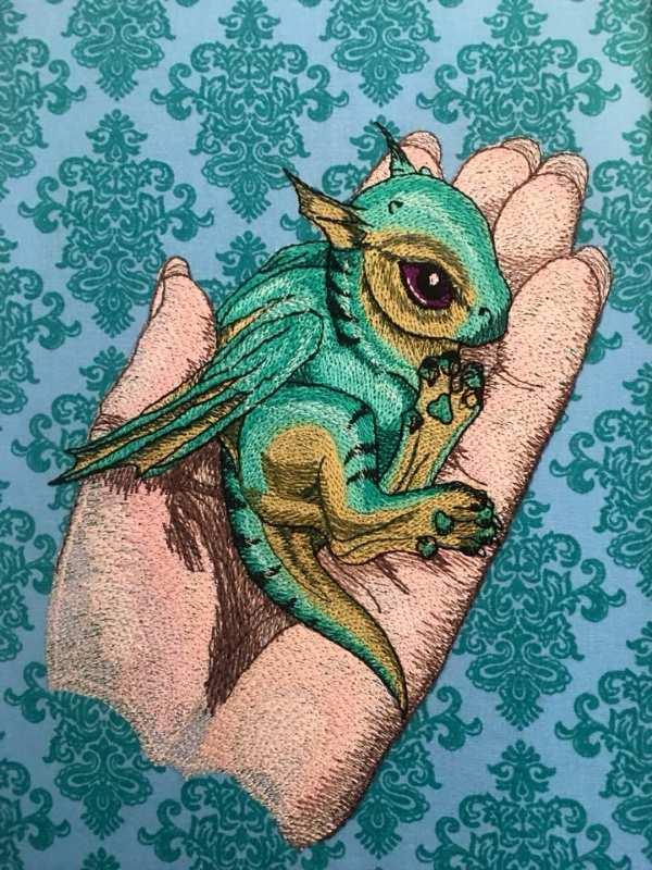 Baby dragon in palm embroidered design