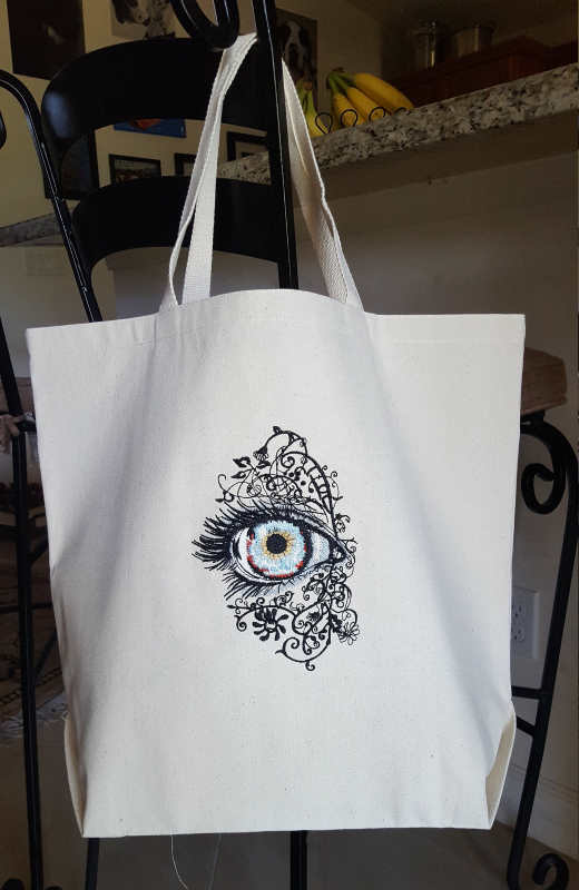 Beach bag with attractive eye embroidery design