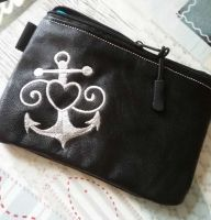 Leather small case with anchor and lifebuoy embroidery design