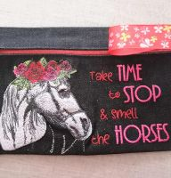 Beauty bag with horse head embroidery design
