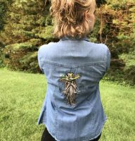 Embroidered jacket with roo man design