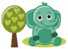 Cute elephant near tree