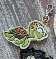 Embroidered key chain with turtle design