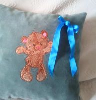 Embroidered cushion with funny teddy bear design