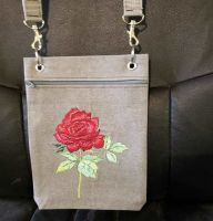 Embroidered handbag with rose design