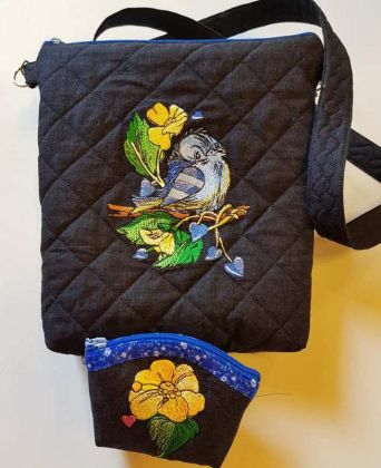 Several embroidered bags with spring sparrow designs